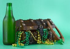Image for Saint Patrick`s Day on March 17th. Treasure chest to symbolize luck and wealth. A bottle of beer and a horseshoe added. stock photography