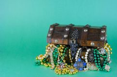 Image for Saint Patrick`s Day on March 17th. Treasure chest to symbolize luck and wealth is filled with costume jewelry and beads. royalty free stock photos