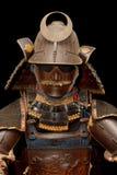 Image of samurai armour on black. Background Stock Photo