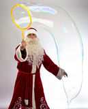 Image of Santa looking at bubble Royalty Free Stock Photography