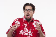 Image of a scared young man in Hawaiian shirt Royalty Free Stock Photo