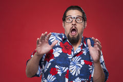 Image of a scared young man in Hawaiian shirt Royalty Free Stock Photos