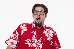 Image of a scared young man in Hawaiian shirt standing against w royalty free stock images