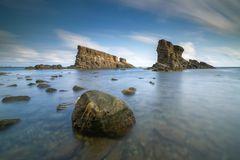 Sea sunrise, near the ship rocks Royalty Free Stock Image