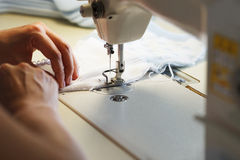 Image of seamstress working on sewing machine Stock Photography