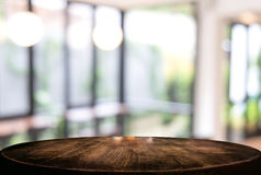 Image of Selected focus empty wooden table and Coffee shop or bl. Urred cafe background of abstract with bokeh image. for montage or display your products Stock Photos