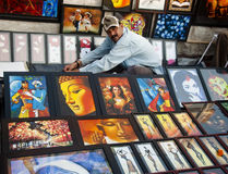 The image seller. A vendor selling images in a local fair in Bengal, India Royalty Free Stock Photography
