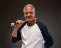 Image of a senior adult man posing with baseball bat Royalty Free Stock Photography