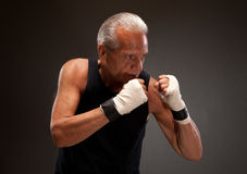 Image of a senior man in a fighting stance Stock Photo