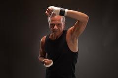 Image of a senior man practicing martial arts Stock Photos