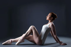 Image of sensual ballet dancer sitting in studio stock image