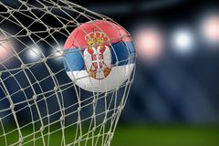 Serbian soccerball in net. Image of Serbian soccerball in net Royalty Free Stock Photography