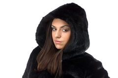 Image of serious woman in fur coat with hood Stock Images