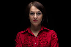 Image of serious woman in red shirt Stock Images