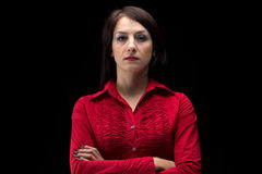 Image serious woman in shirt with arms crossed Stock Image