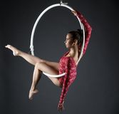 Image of sexy acrobatic girl posing with hoop. Image of sexy acrobatic girl posing with hanging hoop Royalty Free Stock Photo