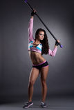 Image of sexy muscular sportswoman holding fitbar Royalty Free Stock Photography