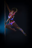 Image of sexy pole dancer posing in jump Stock Photo