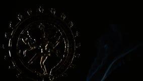 Image of  Shiva, deity of buddhism religion, rotating whit smoke on black background stock video footage