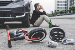 Image of shocked and scared driver after accident involved Kid`s bike and helmet lying on the road on pedestrian crossing after. Accident collision with drunk stock photos