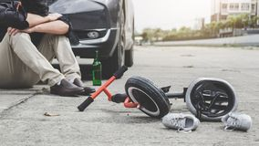 Image of shocked and scared driver after accident involved Kid`s bike and helmet lying on the road on pedestrian crossing after. Accident collision with drunk stock image