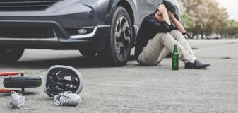 Image of shocked and scared driver after accident involved Kid`s bike and helmet lying on the road on pedestrian crossing after. Accident collision with drunk stock photo