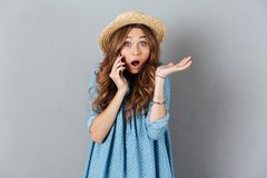 Shocked young caucasian lady talking by phone. Image of shocked young caucasian lady talking by phone. Looking camera Royalty Free Stock Images