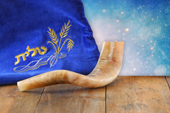 Image of shofar (horn) and prayer case with word talit (prayer) writen on it. room for text. rosh hashanah (jewish holiday) concep Stock Images