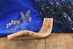 Image of shofar (horn) and prayer case with word talit (prayer) writen on it. room for text. rosh hashanah (jewish holiday) concep Royalty Free Stock Photos