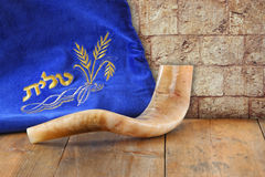 Image of shofar (horn) and prayer case with word talit (prayer) writen on it Stock Photo