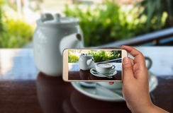 Image of shooting photograph with smartphone Stock Photo
