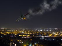 Plane crash. An image showing a crashing passenger plane in mid air, complete with a smoke trail and fire from the engine during night time. A perfect image for stock image