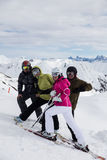 Skiers on a break. Image showing four skiers posing on the slope during a break Stock Image