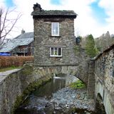 Bridge House spanning Stock Beck. Image showing a house forming a bridge over the Stock Beck river in Ambleside Cumbria Royalty Free Stock Photos