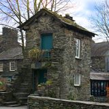 Bridge House, Ambleside. Image showing a house forming a bridge over the Stock Beck river in Cumbria Royalty Free Stock Image