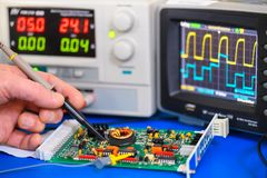Testing an electronics circuit board. Image showing the testing of an electronics circuit board using probes, multimeter and oscilloscope royalty free stock photography