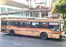 Brown bus in Thailand. The image shows a brown bus running in Thailand. The picture was taken in the October, 2018 in Bangkok royalty free stock images