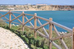 Coast of Algarve, Sagres, Portugal, Europe. Image shows coast of Sagres with hiking trail and wooden balustrade, Algarve, Portugal, Europe Royalty Free Stock Photography