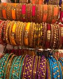 Bangles with ornamentation. The image shows colorful Bangles with ornamentation in gold and artificial pearls royalty free stock photo