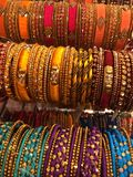 Bangles with ornamentation. The image shows colorful Bangles with ornamentation in gold and artificial pearls stock images