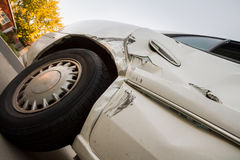 Angled up view looking up at the damage from a car wreck Royalty Free Stock Photos