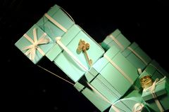 Mint gift boxes, luxury store. Image shows a few stylish gift boxes: worldwide known light mint color, elegant silver white gift ribbons and bows. You may also Stock Images