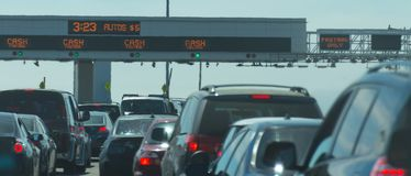 Traffic lining up for toll booths Royalty Free Stock Photos