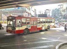 Red bus in Thailand. The image shows a red bus running in Thailand. The picture was taken in the October, 2018 in Bangkok royalty free stock photography