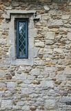 Abstract view of a small, leaded window seen at a famous English castle and palace. stock images