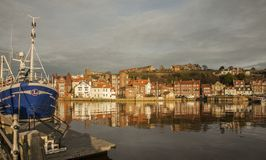 Whitby, Yorkshire, England - the orange houses. This image shows some houses in Whitby, Yorkshire. It was taken at sunset, we can see the reflection of the Stock Images