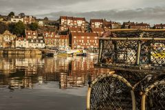 Whitby, Yorkshire, England - the orange houses. This image shows some houses in Whitby, Yorkshire. It was taken at sunset, we can see the reflection of the Stock Photography