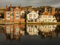 Whitby, Yorkshire, England - a sunny evening and refelections. This image shows some houses in Whitby, Yorkshire. It was taken at sunset, we can see the Stock Images