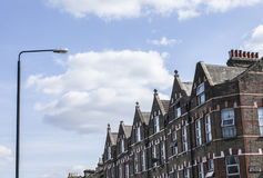 London - a lamp post. This image shows a street in London - a wall of houses and a lamp post Stock Photography
