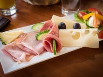 Traditional breakfast in coffeehouse. Image shows a typical continental breakfast served in a traditional coffeehouse; plate contains cold cuts, cheese, cream Royalty Free Stock Photography